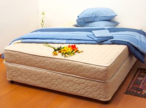 Clean mattress with fresh spring flowers