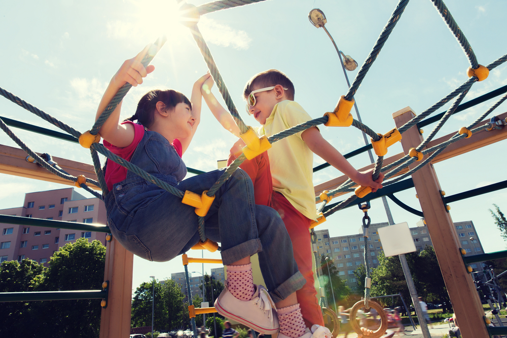children playing on climbing frame